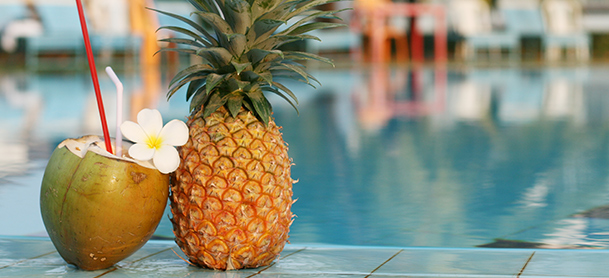Coconut drink next to pineapple