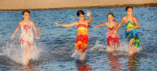 Kids dressed up running in water