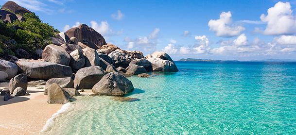 Large rocks near clear blue ocean water