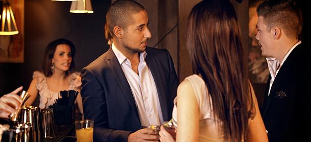 People mingling at bar