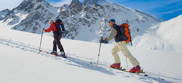People cross country skiing in mountain range