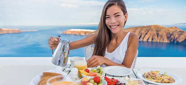 Smiling woman enoying breakfast
