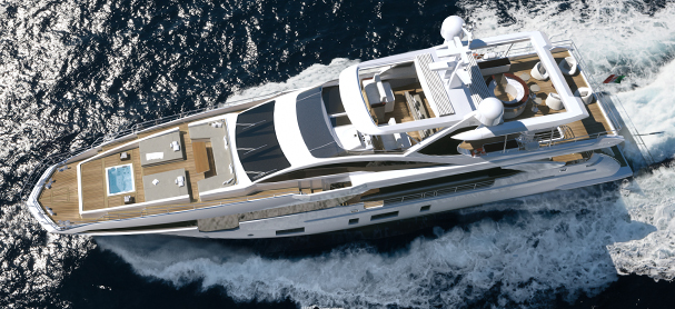 An aerial view of a yacht cruising from right to left