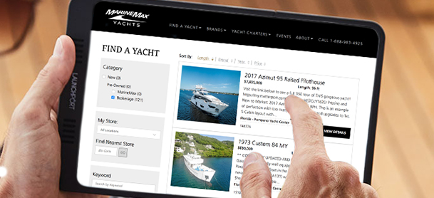 Browsing yachts on tablet