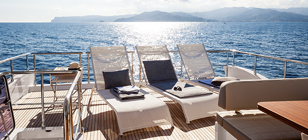 chairs on the aft deck of a yacht
