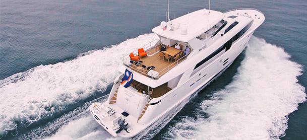 Large white yacht running