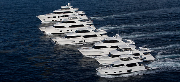 group of large yachts running together