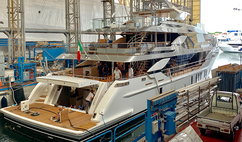 a yacht under construction in a factory in italy