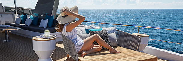 Lady lounging on flybridge of Hatteras M90 Pancera