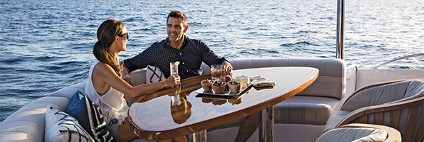 Couple sitting at table on Hatteras Yacht