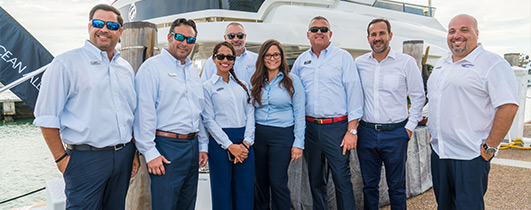 marinemax yachts team standing on the docks