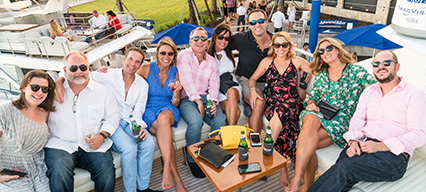 Group of people sitting on a yacht during event