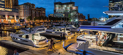 yachts along dock at night