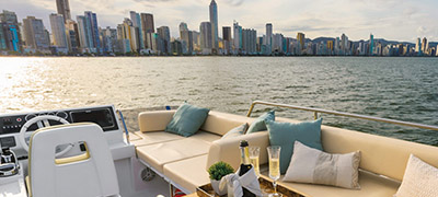 open deck of a yacht with city skyline in background