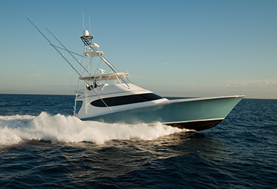 A Hatteras GT70 cruising in the water