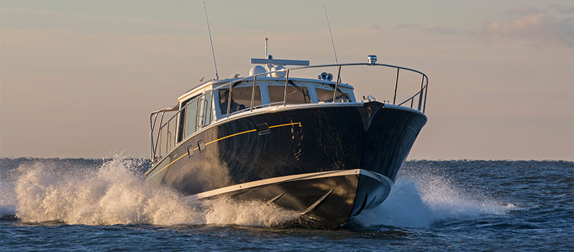 MJM Yachts 50z cruising bow first and making waves