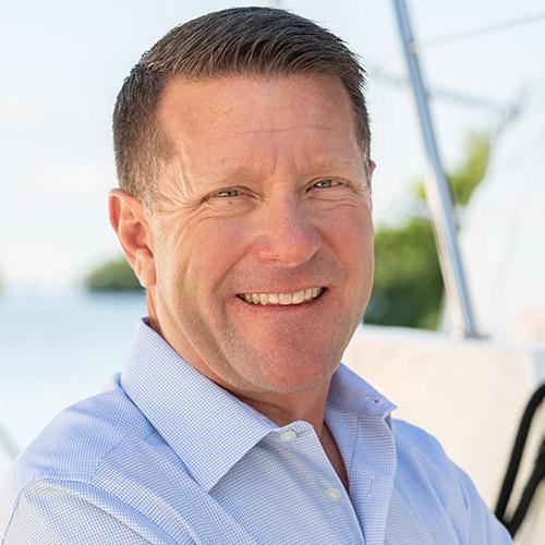 A headshot of a yacht salesman